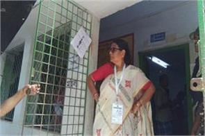 tmc women mp surrounded by security personnel at polling station