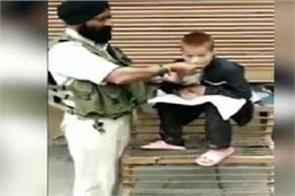 crpf jawan serving food to divyang child has been honored