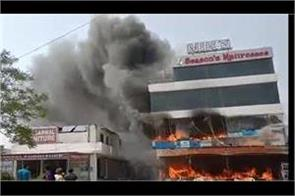 three storey furniture showroom fire loss of millions