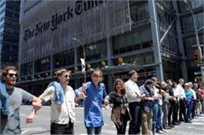 70 people arrested in climate protest outside new york times building