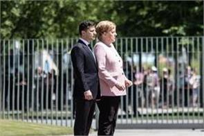 germany s merkel appears unsteady shaking at ceremon
