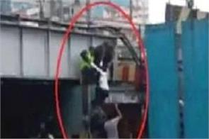 malaysian woman trapped in the rain of mumbai