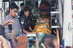 the flag of the bjd was wrapped on the coffin of the martyr