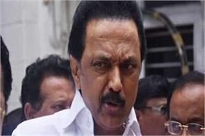 dmk opposes center s  one country one ration card  scheme