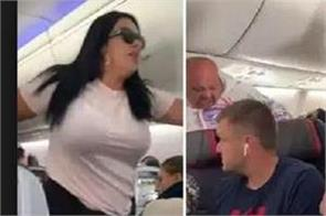 plane passenger throws laptop at boyfriend for  looking at other women