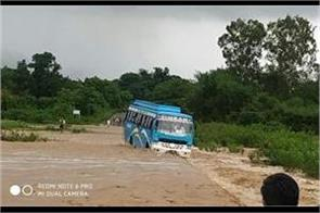 bus caught in flood in kathua