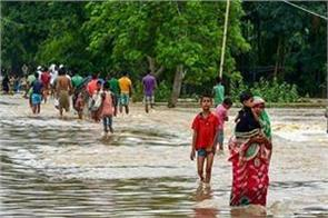 the number of those killed in floods in assam increased to 11