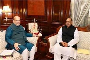 amit shah expressed concern to bangladesh about illegal infiltration