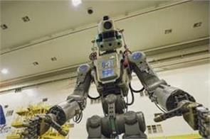 russian life size humanoid robot successfully reach into space