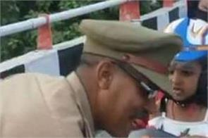 traffic police inspector salutes mother and daughter