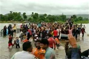 people dancing heavily on the national highway filled with water