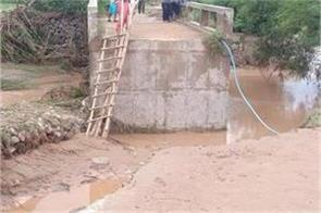 dam of naggal broken part of bridge shed water filled in many villages