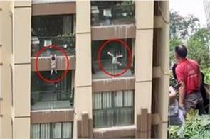 boy falls 6 stories in china saved by crowd below in dramatic video