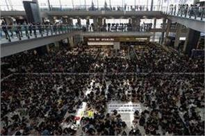 protesters protest at hong kong airport hundreds of flights canceled