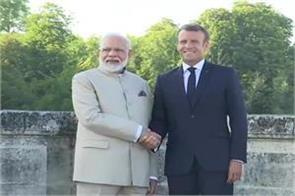 pm modi arrives in france meets president emmanuel macron