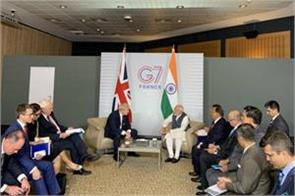 modi meets uk prime minister johnson in france