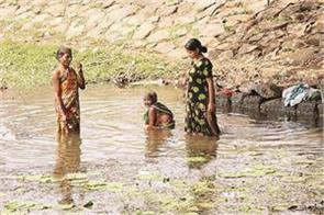 rural women still have to bathe in the open with clothes