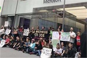 over 70 arrested in immigration protest at microsoft store in us