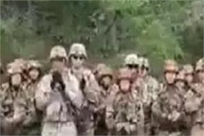indian and american soldiers dance on the assam regiment marching song
