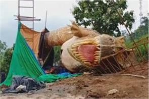 a 30 foot dinosaur being built near the statue of unity collapsed
