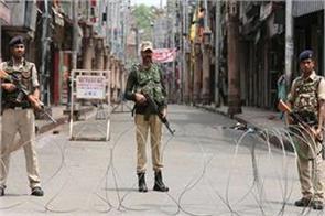 curfew enforced to prevent muharram procession in srinagar