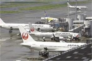 more than 200 flights postponed due to hurricane factory in japan