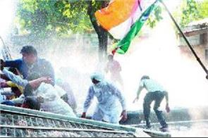 water cannon fired on congressmen traveling towards bjp office