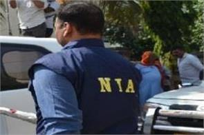 nia raids nine bases in srinagar and delhi
