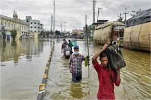 hyderabad people suffering from floods threw slippers at the mla