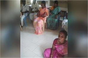 female panchayat leader seated on ground in meeting due to caste