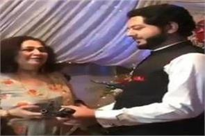 pakistan woman gave ak 47 rifle as gift to groom video goes viral