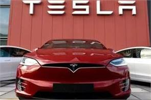 tesla to open sales center in india in 2021 gadkari