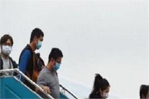 international news punjab kesari corona positive us flight css