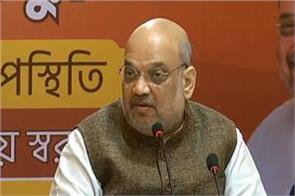 tomar can meet protesting farmers in a day or two amit shah