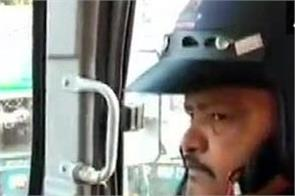 driver driving bus wearing helmet