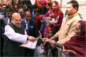 delhi election amit shah did door to door campaign