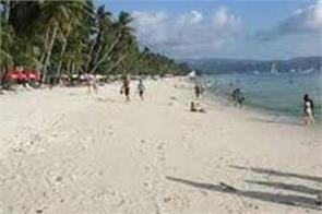 couple arrested while intimating on beach continue in police van