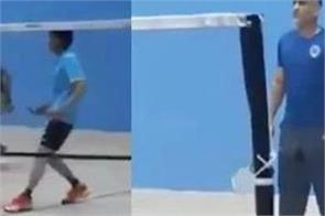 dhoni is not afraid of corona virus mahi landed in ranchi to play badminton