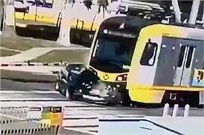 horrifying footage shows bmw getting crushed by train