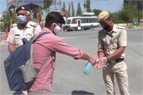 young distributed sanitizers to police personnel for free haryana news