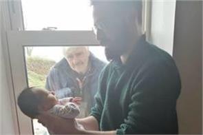 coronavirus grandpa first sees grandson face from window