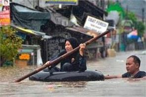 flash flood kills 16 in indonesia 23 still missing