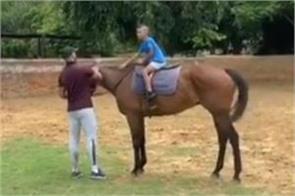 indian opener dhawan seen teaching horse riding to son zorawar video