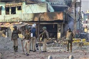 delhi riots names of salman khurshid and prashant bhushan in the charge sheet