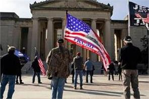 small numbers of protesters gather at fortified us statehouses