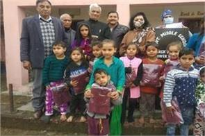 school sweaters distributed among students