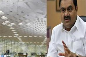 adani group gets command of mumbai airport