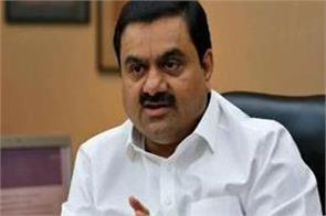 gautam adani to be no 1 in earnings this year defeating jeff