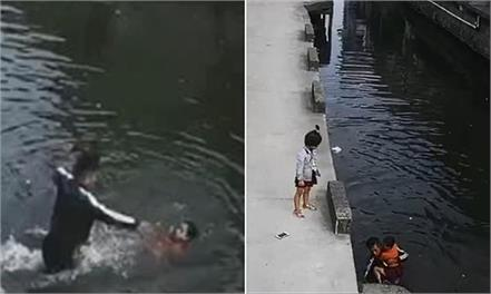 china little girl falls into a river saved by a passing delivery driver