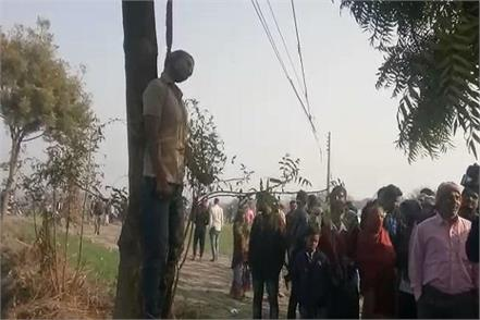 the body of the young man who was hanged from a neem tree in faridabad